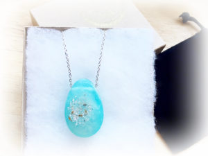 Ashes, 24 carat gold specks, gentle iridescent pigment in light blue epoxy resin